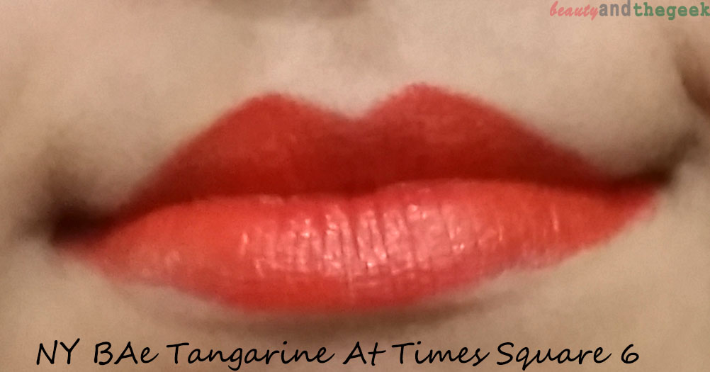 NY Bae Lipstick Creamy Matte tangarine at time sqaure 6 lip swatch